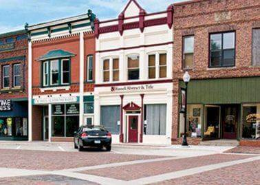 Seven brick buildings on main street of Adel