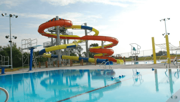 Large pool and yellow and orange winding waterslides